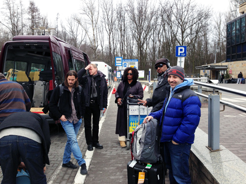 Welcome to Krakow! The band, just having gone through the red eye from NYC deals with the gear and the bus. Right to left, Peter Martin, Terryon, Dianne, and the crew.
