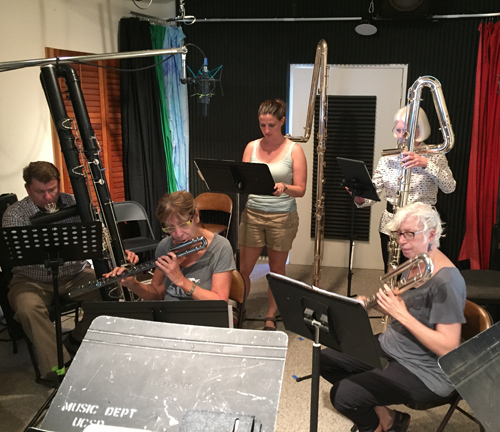 Low end flutists getting ready to record.