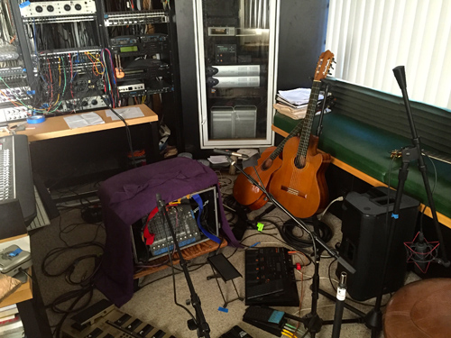 This is the control center for the recording project this week. Gear and cables everywhere, doing their best to get the music to the computer.