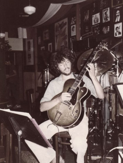 Me grinning and picking at Mulberry St. in Studio City way back in the day.