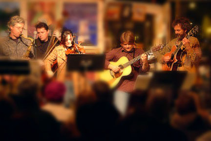 Love this pic from back many years. It's the Strummers with (left to right) Ken Dow on bass, Sara Watkins on fiddle, Sean Watkins on guitar, and Peter on guitar. We invaded in on the Artists 101 Space in Encinitas and took over with music! photo by Mark Keller
