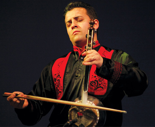 Azerbaijani muso Imamyar Hasanov playing their version of the violin.