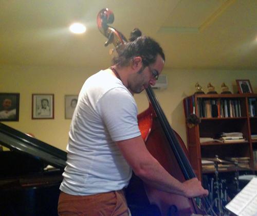 Carlitos del Puerto on the bass.