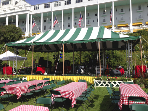 The outdoor concert setup during sound check. That's the old hotel in the back.