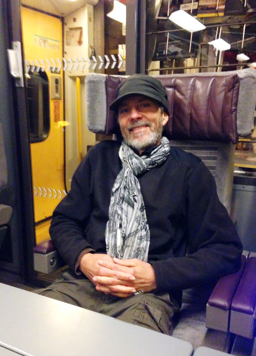 """On the train from France to London. I'm bundled up and even though the train is warm I'm still defrosting from the """"coldest train station in the world""""."""