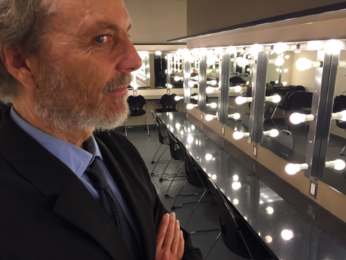 Peter can wear a suit too! Barely! This is me in the dressing room with mirrors and lights forever.