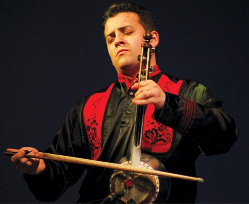 Azerbaijani muso Imamyar Hasanov playing their version of the violin.